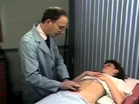 woman examination on the belly - YouTube